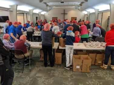 Scouts packing food for Rise Against Hunger